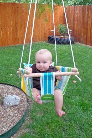 DIY colorful striped baby swing of fabric (via wonderfuldiy.com)