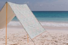 DIY beach tent of fabric and pipes