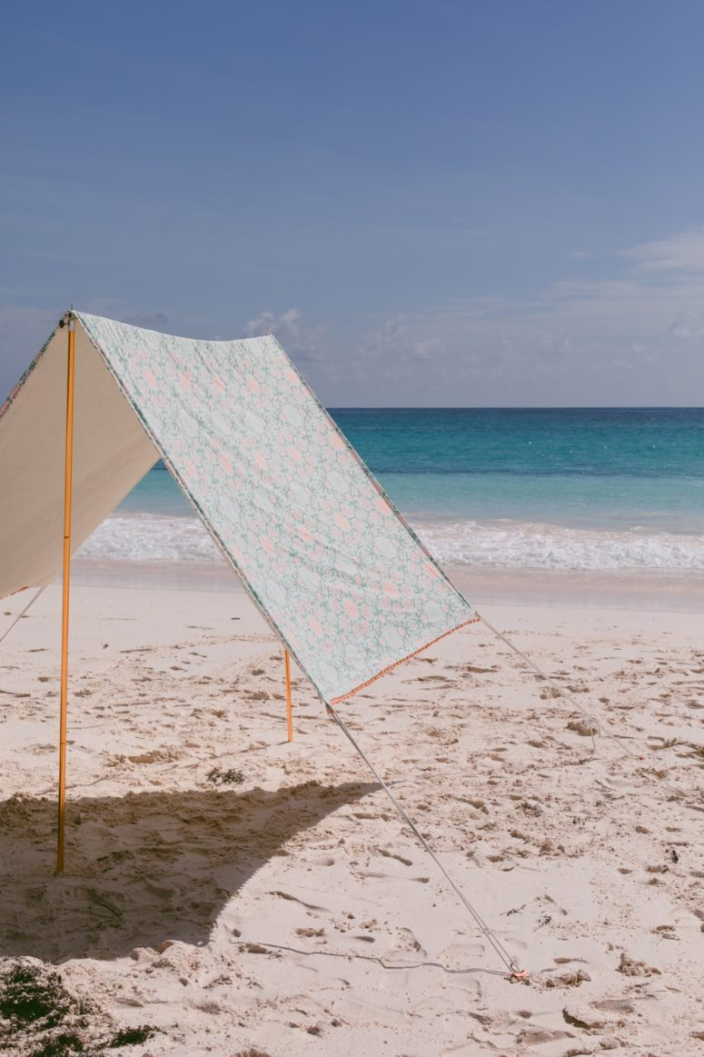 DIY beach tent of fabric and pipes (via ruffledblog.com)