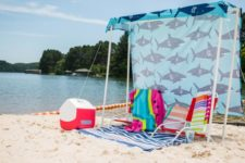 simple DIY beach tent of a shower curtain and PVC pipes
