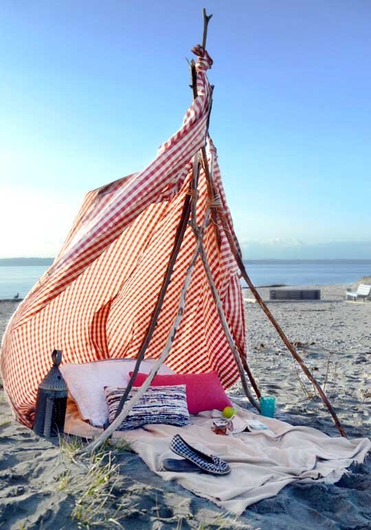 DIY boho beach tent using sticks and a shower curtain (via thesimplesol.com)