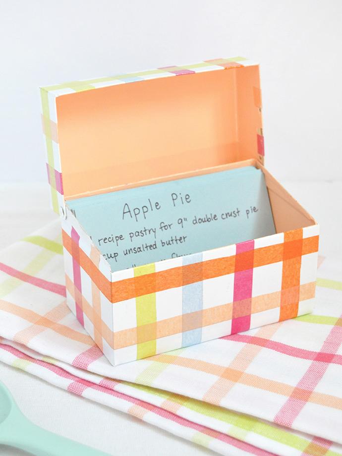 DIY colorful plaid recipe box using a tin box (via www.handmadecharlotte.com)