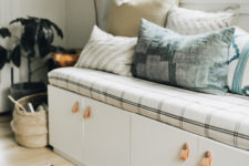 DIY upholstered bench with plenty of storage made of IKEA Sektion cabinets