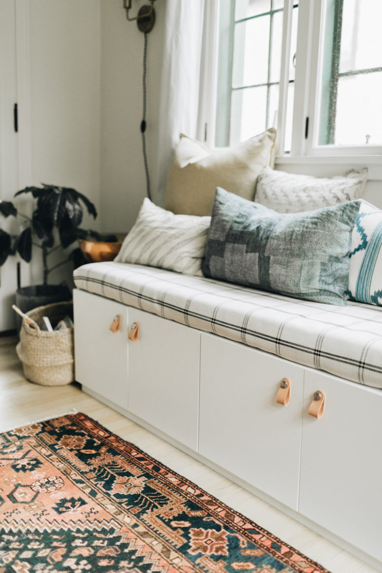 DIY upholstered bench with plenty of storage made of IKEA Sektion cabinets (via witanddelight.com)