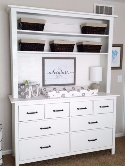 a Hemnes dresser turned into a changing table with a hood with shelves is a very functional idea
