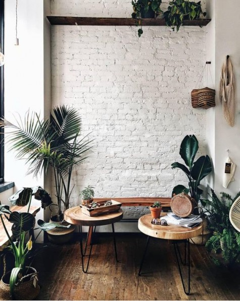 a white brick wall is a great solution for this boho chic nook and it looks very organic and natural here