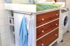 03 a Hemnes dresser with stained wood drawers, a comfy top and side open shelves for a changing table