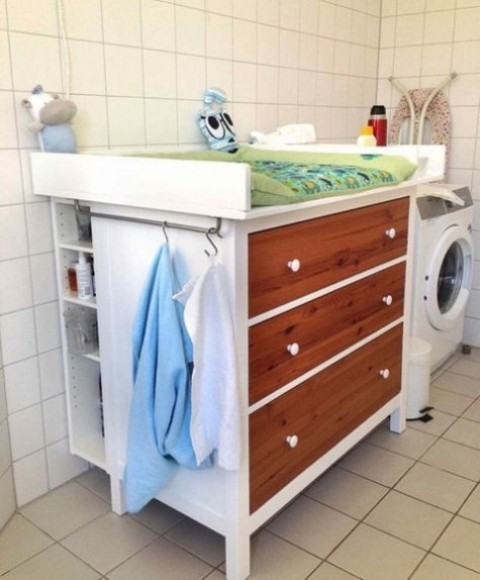 a Hemnes dresser with stained wood drawers, a comfy top and side open shelves for a changing table