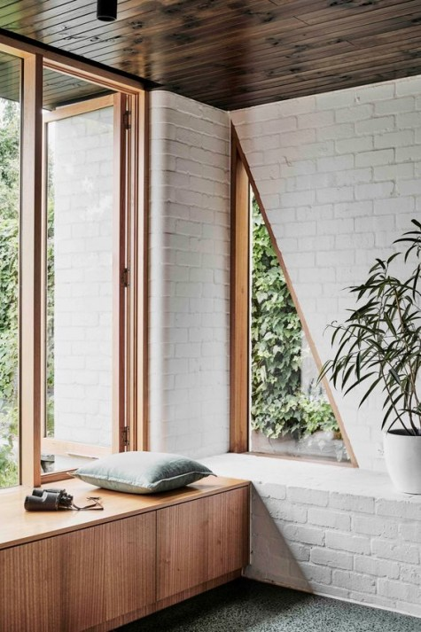 white brick clad can fit any style, here it's chosen for a mid-century modern space and looks totally fine