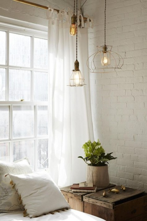 white bricks bring a soothing and peaceful touch to the bedroom, it's a great idea for such a space