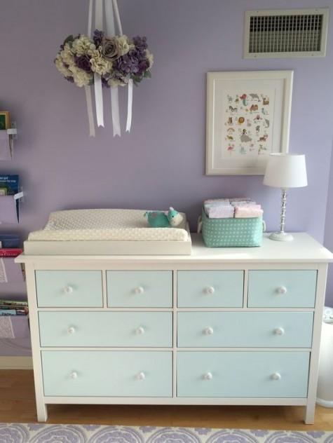 an IKEA Hemnes dresser painted aqua to fit the color scheme of the nursery