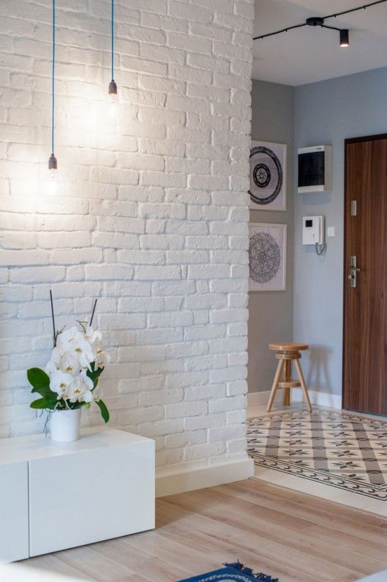 white brick walls look very textural and brign an edgy feel to the space at once