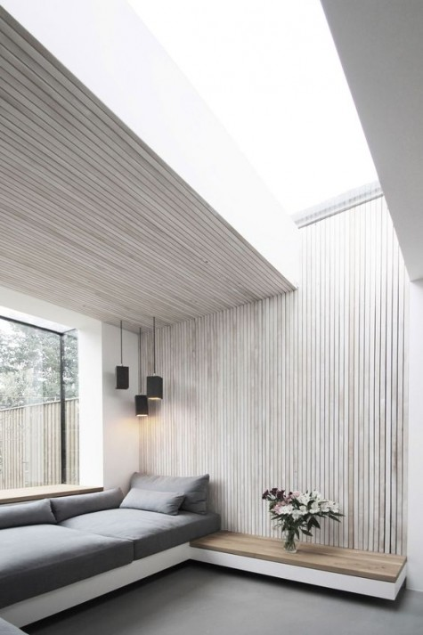 a minimalist space with whitewashed wooden planks on the wall and ceiling