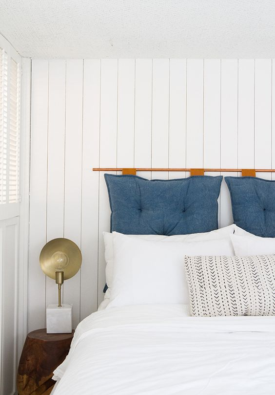 white wooden plank walls create a relaxed and fresh feel in the bedroom and make it bright