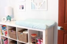 11 an IKEA Expedit wall unit with open storage spaces and baskets as a changing table