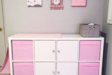 13 an IKEA Kallax shelf turned into a pink girlish changing table with storage compartments and boxes