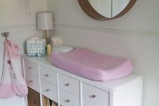 14 an IKEA Kallax shelf with drawers and woven baskets for a stylish changing table with a rustic touch