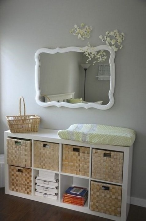 an IKEA Kallax shelf with woven baskets as drawers is a chic rustic changing table with a cozy feel