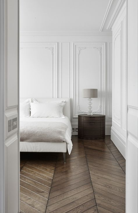 white paneling makes the bedroom super refined and chic at once, just add some furniture to this backdrop
