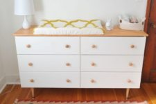 18 an IKEA Tarva dresser with a light-colored wooden top and matching pulls and legs used as a changing table