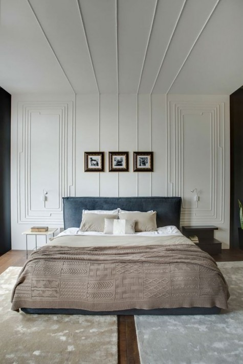 molding on the wall and ceiling make the bedroom sophisticated and very eye-catching