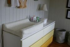21 an ombre IKEA Malm dresser turned into a colorful changing table that will add a touch of color to the space