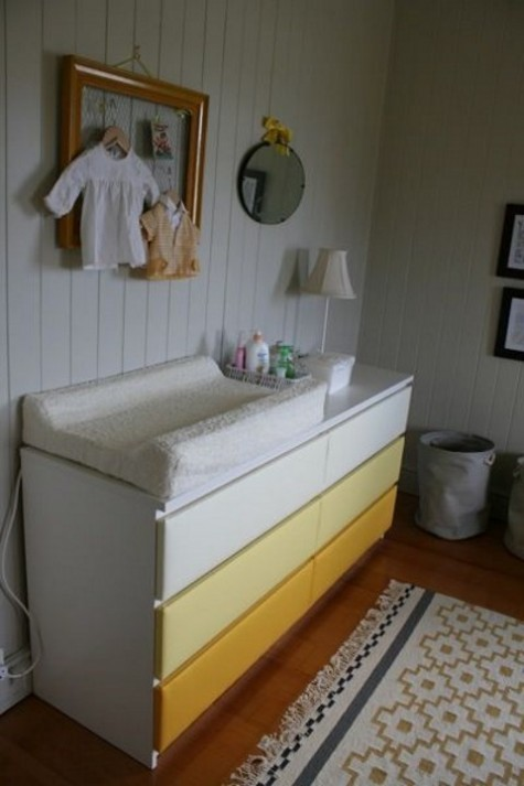 an ombre IKEA Malm dresser turned into a colorful changing table that will add a touch of color to the space