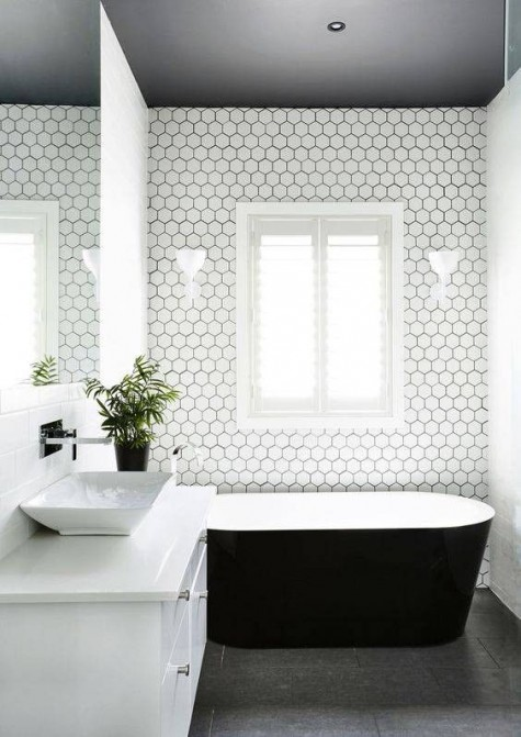white hexagon tiles are highlighted with black grout in this minimalist bathroom
