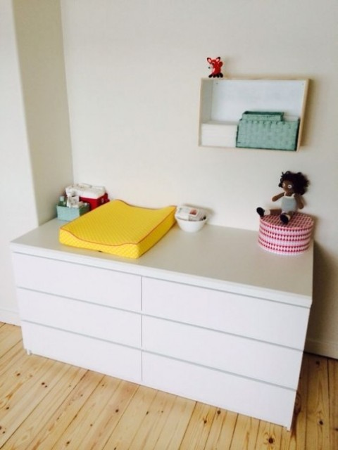 sleek IKEA Malm dresser used as a changing table is a great solution for many nurseries