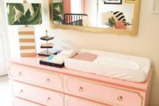 23 a beautiful hack of an IKEA Malm dresser in salmon pink and with gold inlays and ring pulls