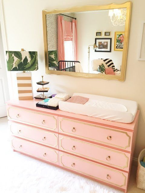 a beautiful hack of an IKEA Malm dresser in salmon pink and with gold inlays and ring pulls