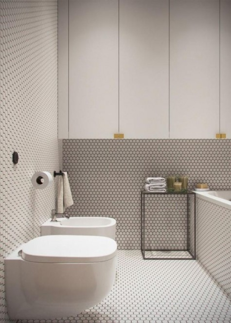white penny tiles with black grout create a very textural look and contrast sleek white cabinets