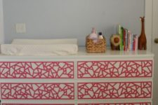 24 an IKEA Malm dresser hacked with bold red geometric inlays for a colorful touch in the nursery