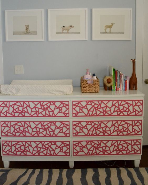 an IKEA Malm dresser hacked with bold red geometric inlays for a colorful touch in the nursery
