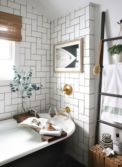 white tiles clad in an eye-catchy pattern and highlighted with black grout for a wow effect