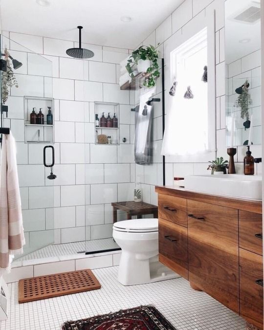 oversized white tiles paired with black grout that accents them and make them look cooler