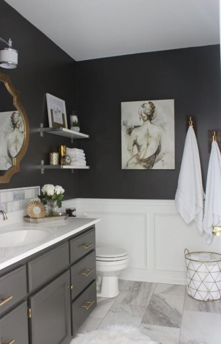 a black bathroom is spruced up with white wainscoting and a marble tile floor   use waterproof sealants