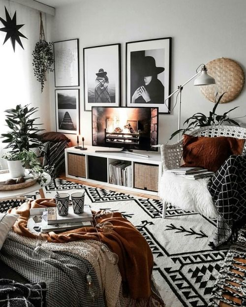 a bold boho living room with printed textiles, touches of wicker and jute and a stylish black and white gallery wall