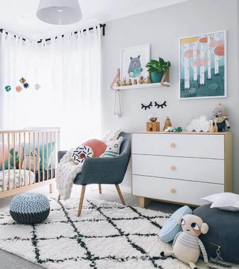 a bright contemporary nursery in white with touches of muted and pastel colors here and there