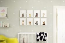 a bright nursery in grey, white and bright yellow, a gallery wall, a neon yellow chair and star print wallpaper