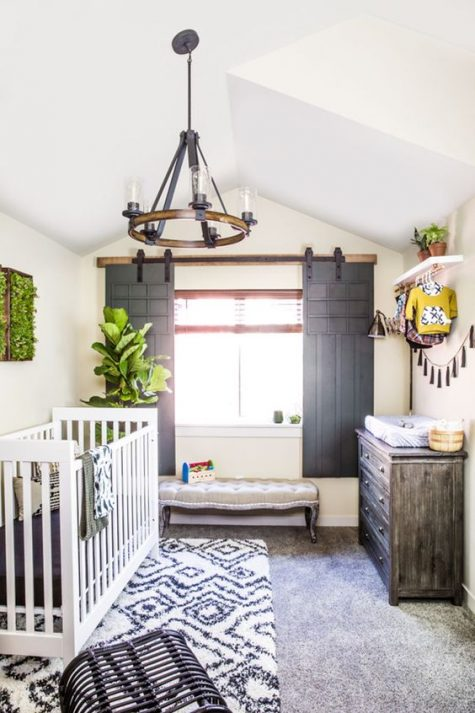 a gorgeous rustic nursery with sliding shutters, a wooden chandelier, a weathered dresser and prints