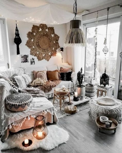 a neutral gypsy space with macrame boho pillows rugs and ottomans a fringe lamp and boho lamps