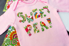 DIY pink onesie with colorful letter appliques