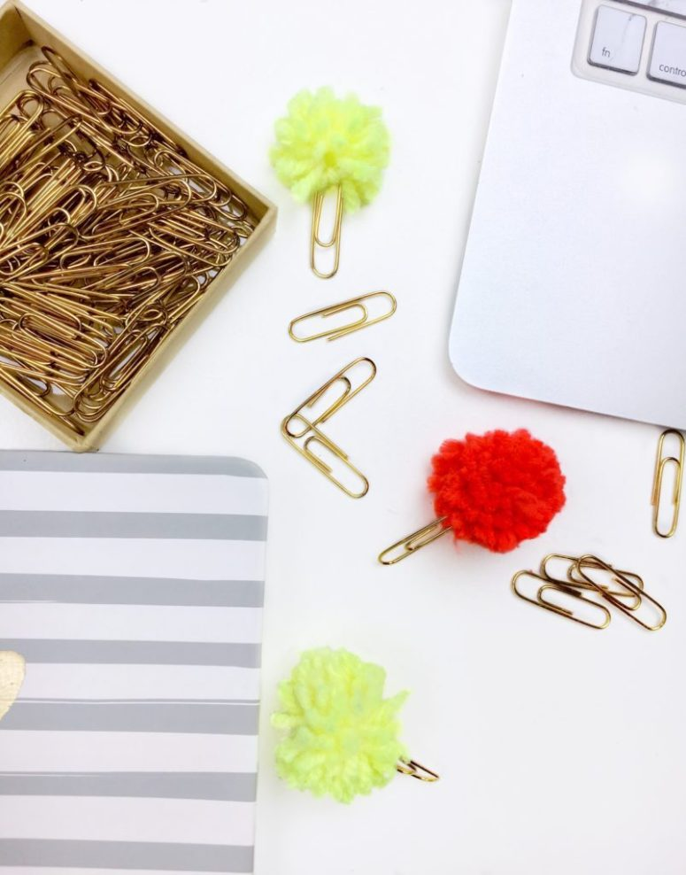 DIY paper clips with colorful pompoms on top (via www.cassiescroggins.com)