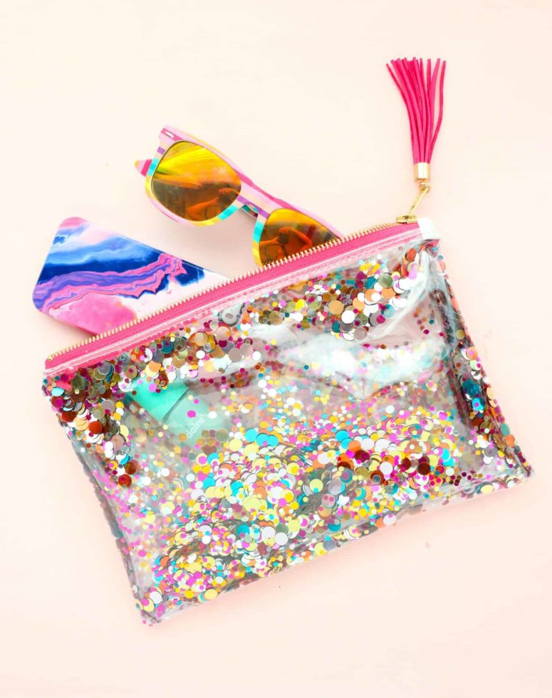 DIY water resistant vinyl pouch with bright decor (via abeautifulmess.com)