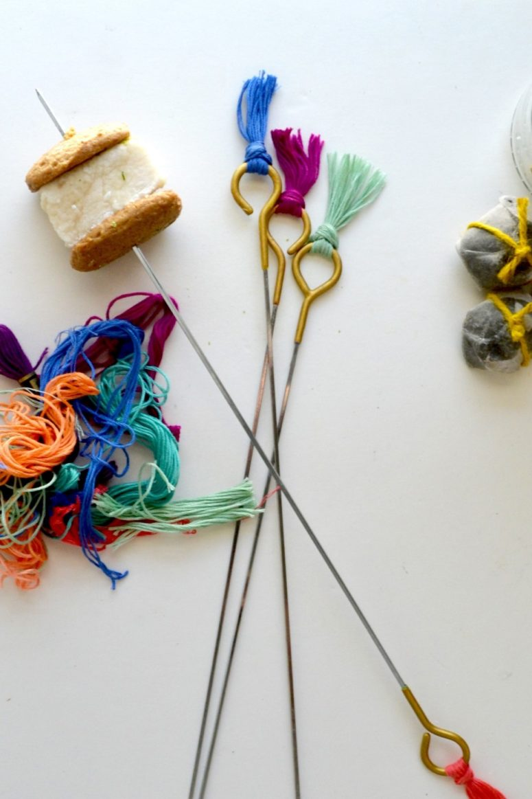 DIY roasting sticks spruced up with colorful tassels (via www.twineandtable.com)
