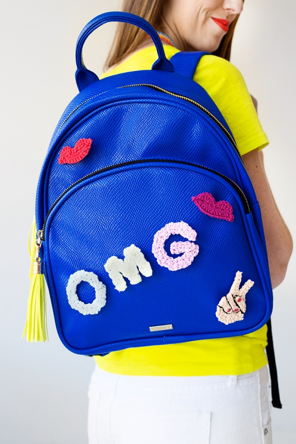 DIY colorful backpack upgraded with crochet details (via studiodiy.com)