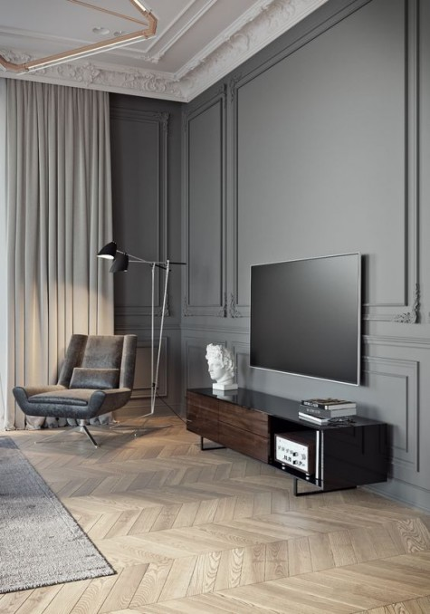 grey paneling and molding on the ceiling create a refined space, and contemporary furniture contrast it