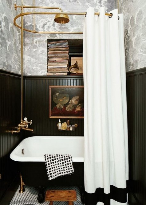 tall black wainscoting and grey printed wallpaper to create a stylish retro bathroom look