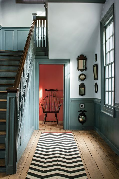 teal colored paneling brings color to the space and makes it feel a bit vintage-like